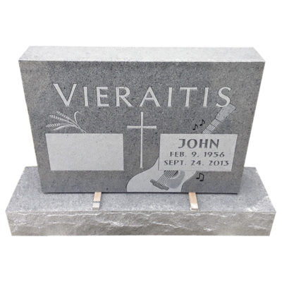 Simple two grave monument with guitar design