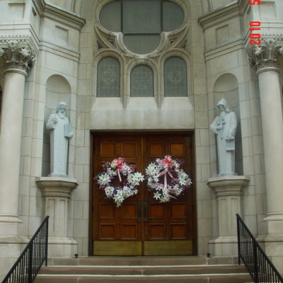 2 Life Sized Custom carvings of Saints at Church Entrance